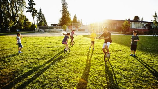 Children playing soccer on a field