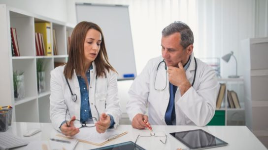 Two clinicians working together