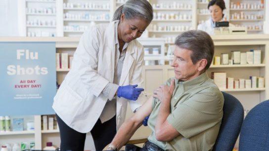 A man receiving a flu shot