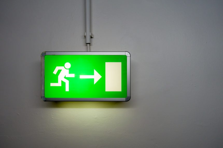 Green, white figure, sign, on wall