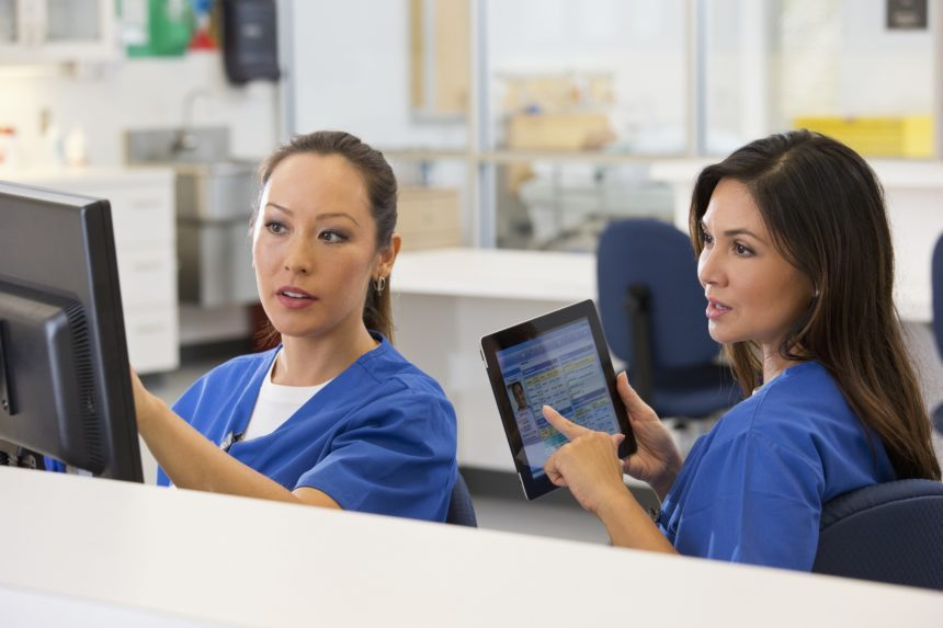 nurses, computers, working together