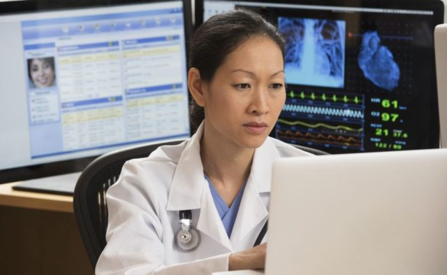 A physician on the computer