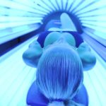 A woman indoor tanning