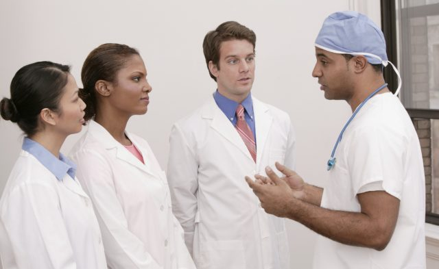 surgeon talking to interns