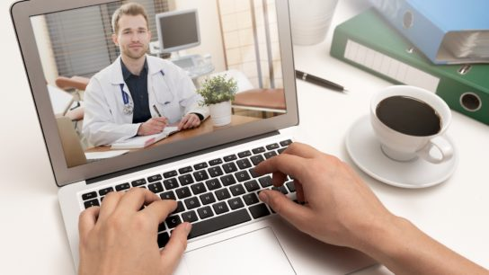 Doctor on the computer laptop screen.