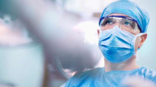 Surgeon in an operating room.